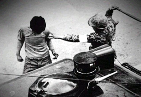 Korean protester captured by a South Korean soldier during the democratic uprising in Kwangju. May 1980.