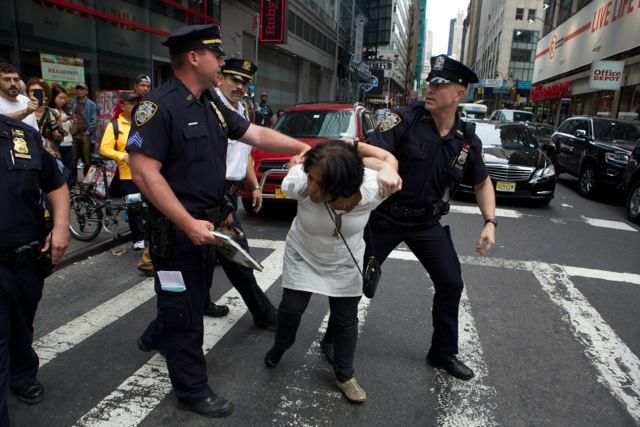 Chaumtoli Huq being restrained by NYPD police officers on a street in Times Square (picture courtesy of Chaumtoli Huq)